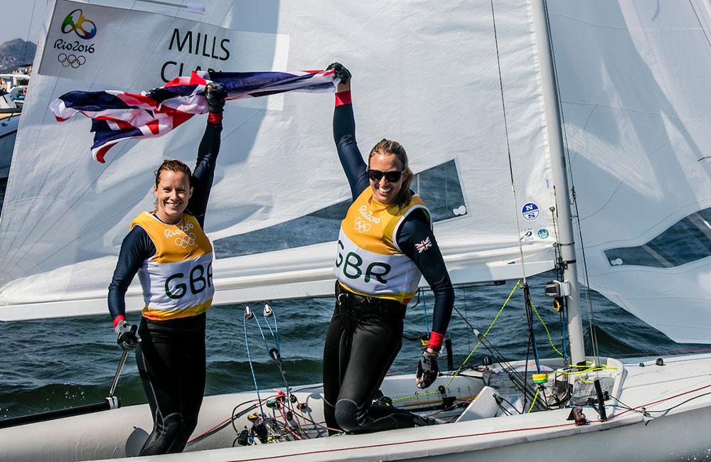 Hannah Mills Saskia Clark celebrate gold. 2016 Rio Olympic Games: Sailing: Photo Sailing Energy/World Sailing.