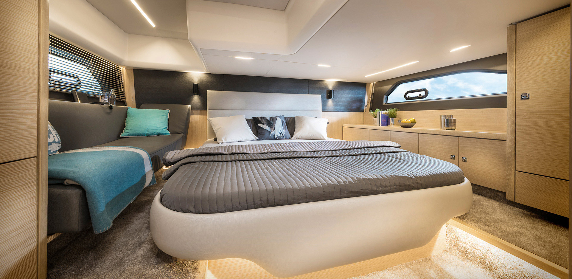 There's sleeping for four in two cabins, with plenty of storage and generous headroom.