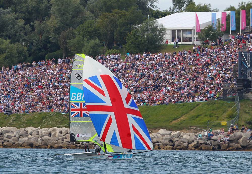 This photo captures the medal race sailing at the 2012 Olympic Games, as a 49er races close to the crowds.