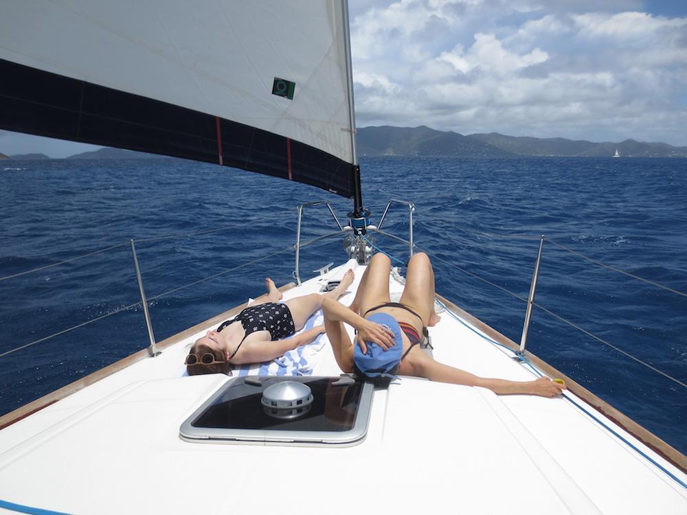 Sunbathing on a yacht charter in the British Virgin Islands