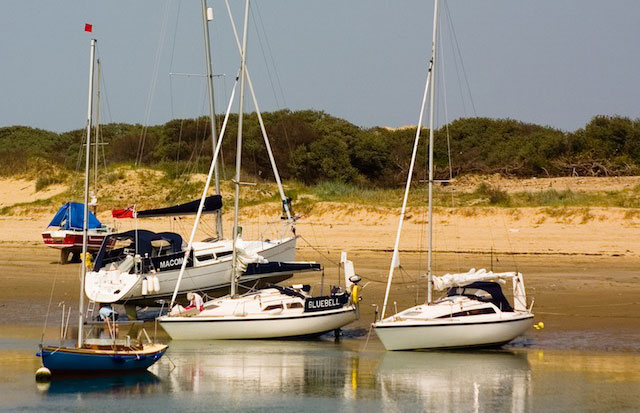 Boats dried out on moorings