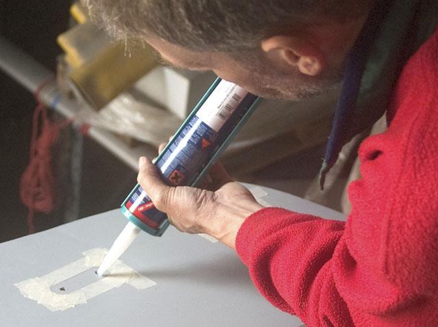 Fix leaking decks: applying sealant