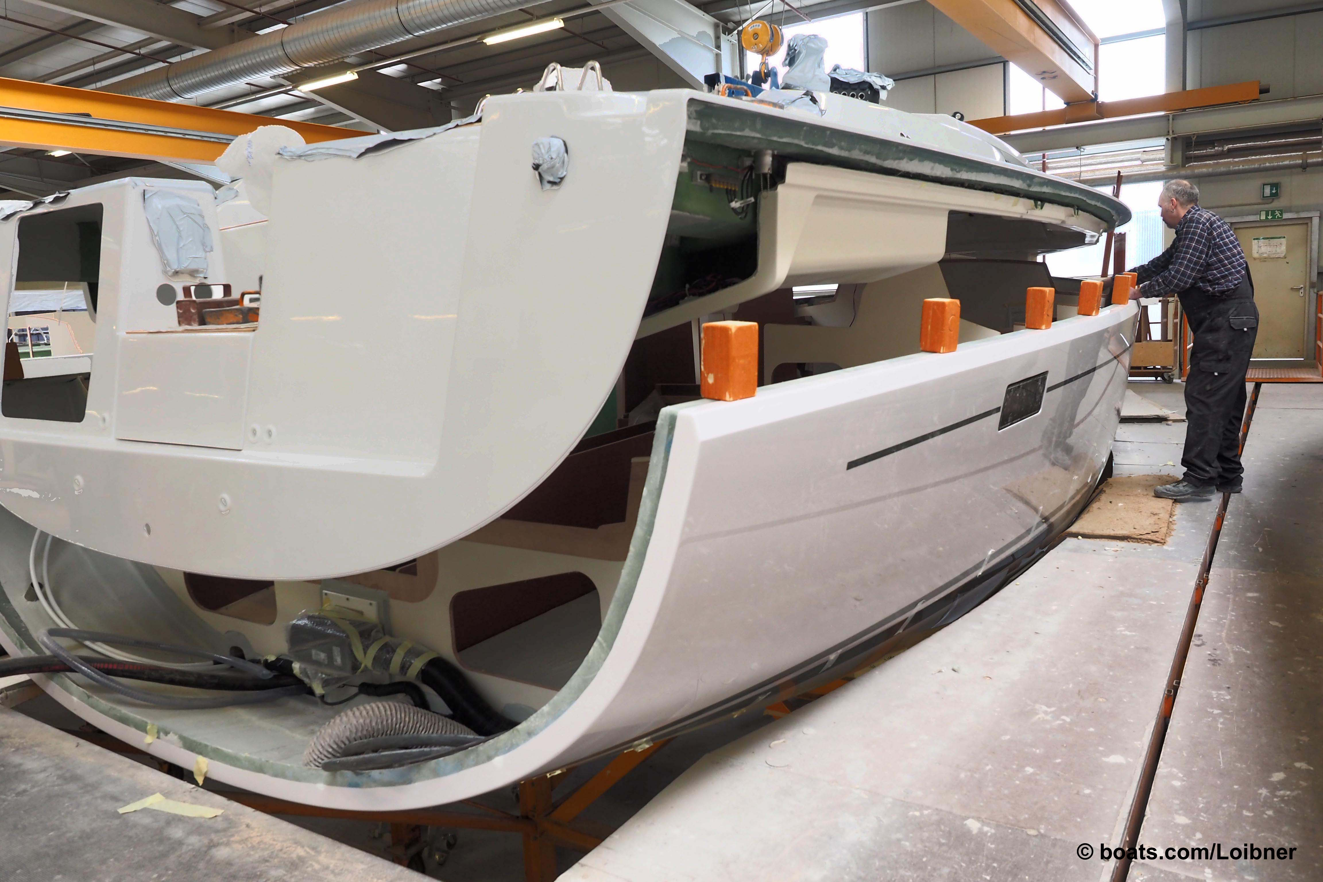 Once the interior is completely installed the deck is fitted to Hanse's sailing yachts.