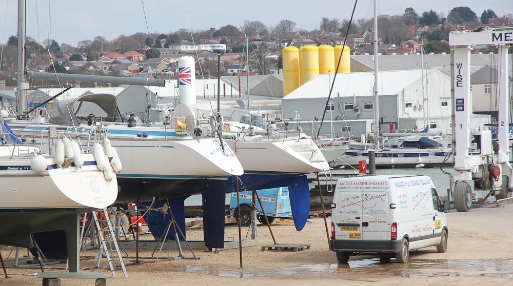 Yachts ashore in a busy boat yard
