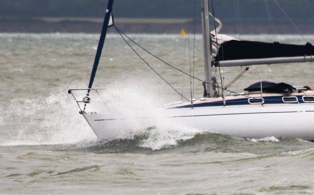 Motoring a yacht into rough seas