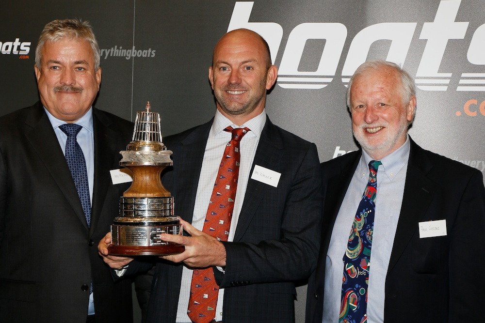 Ian Walker, last year's winner of the boats.com YJA Yachtsman of the Year Award, presented by Ian Atkins, CEO of boats.com (left) and Paul Gelder, Chairman of the Yachting Journalists' Association, at Trinity House, London.