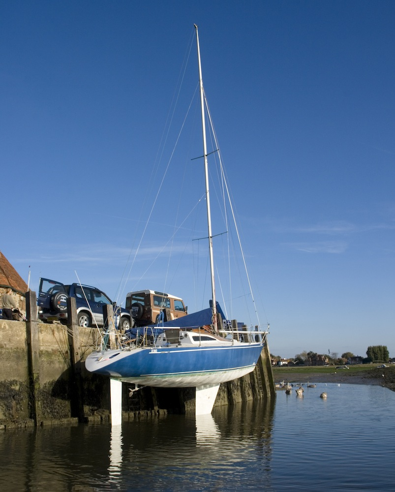 A yacht mid season after scrubbing awaiting a new coat of antifouling