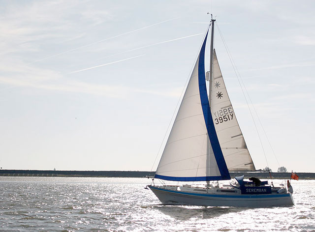 A bilge keeled boat under sail