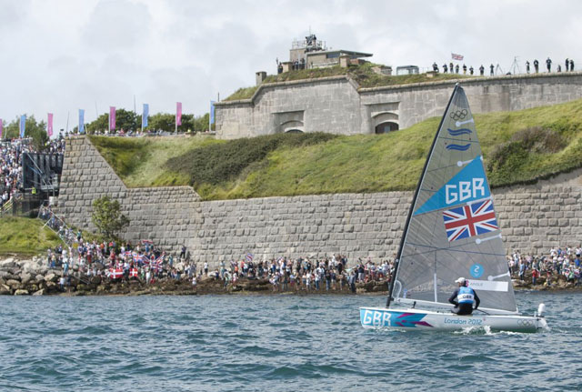 Ben Ainslie sailing off the Nothe in Weymouth