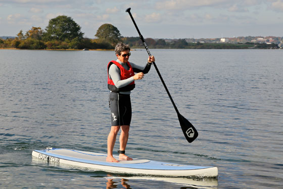 stand up paddleboard changing hands