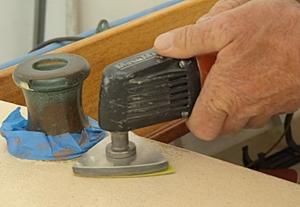Sanding to prepare for painting decks.
