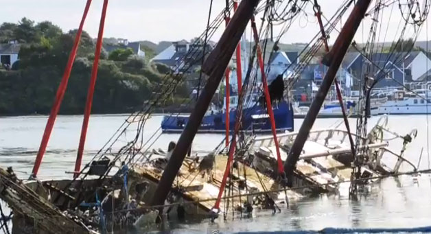 The Tall Ship Astrid is lifted from rocks off Cork.